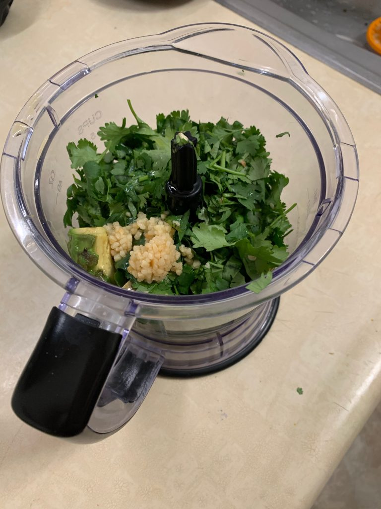 show the herbed avocado aioli ingredients in the food processor