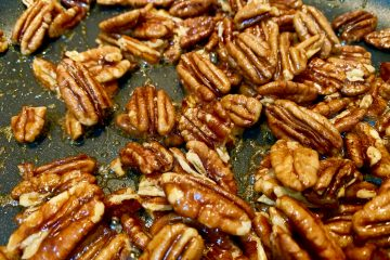 Close up of maple pecans in a pan