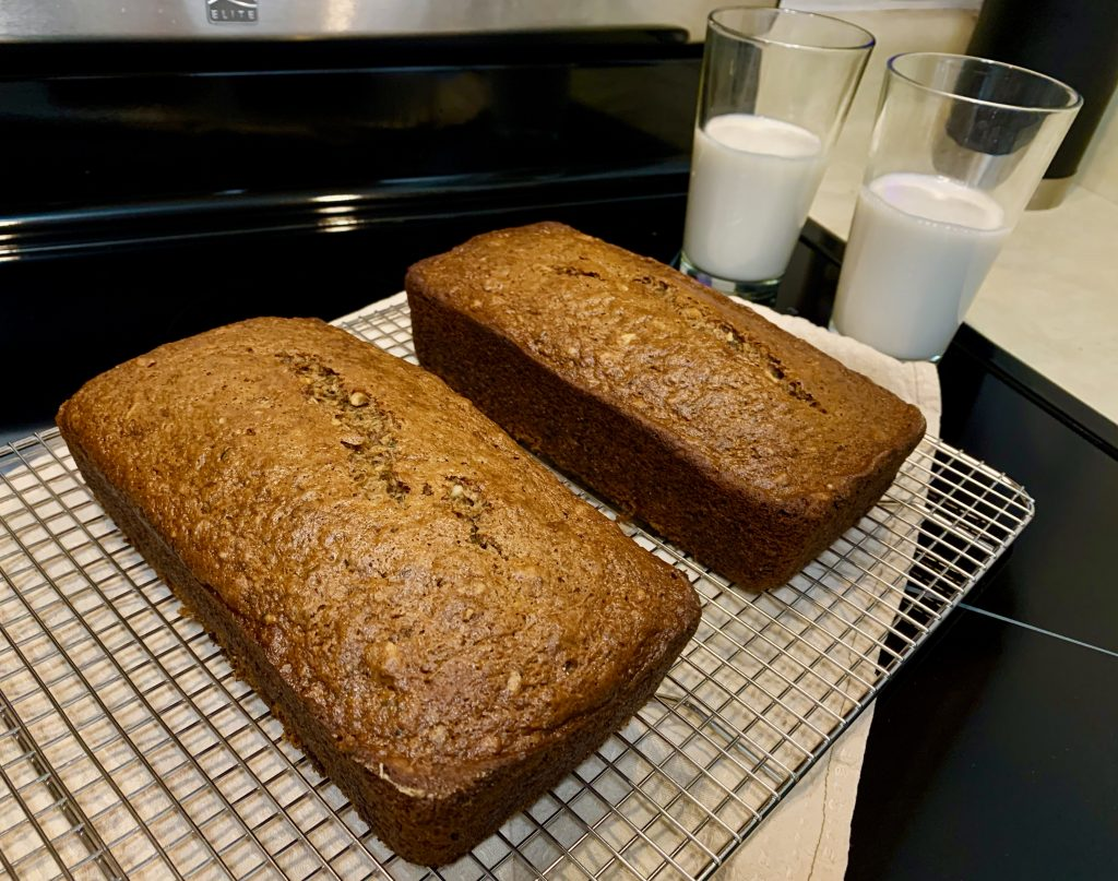 2 loaves vegan zucchini bread with rice milk in glasses