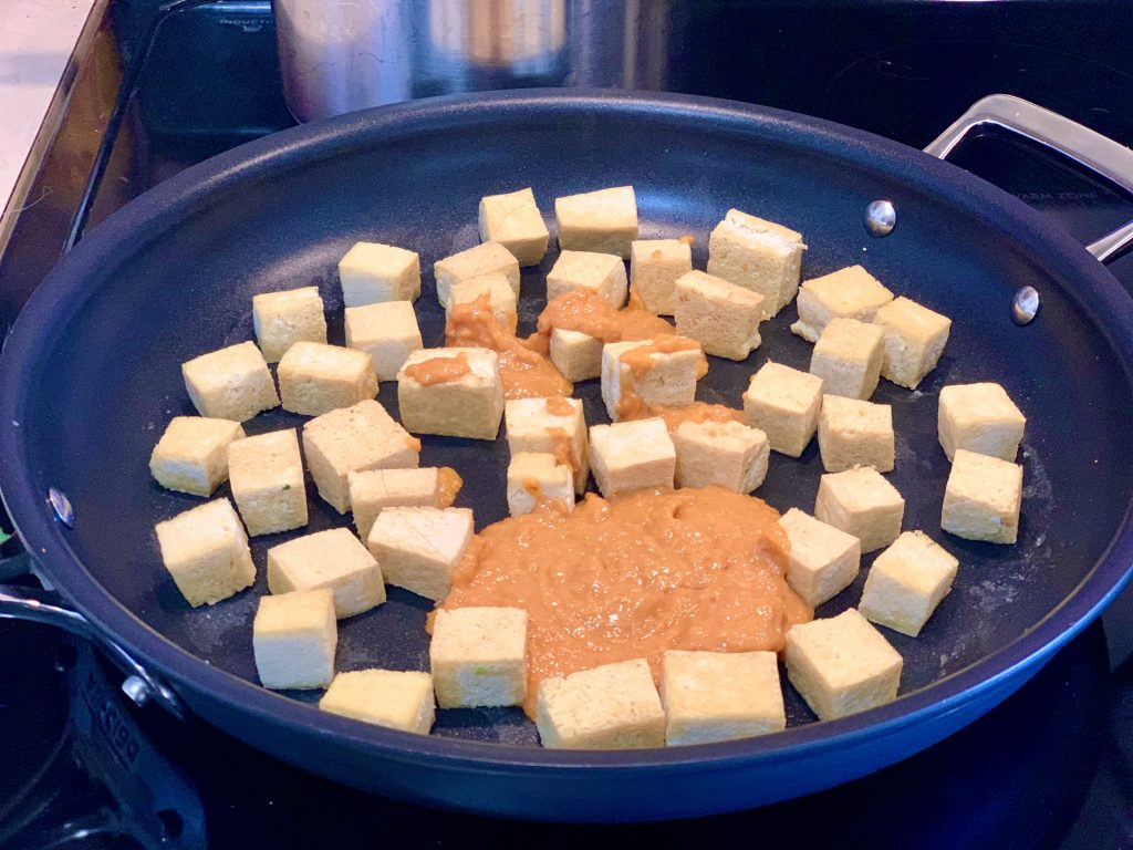 Adding Miso Base to tofu in the pan