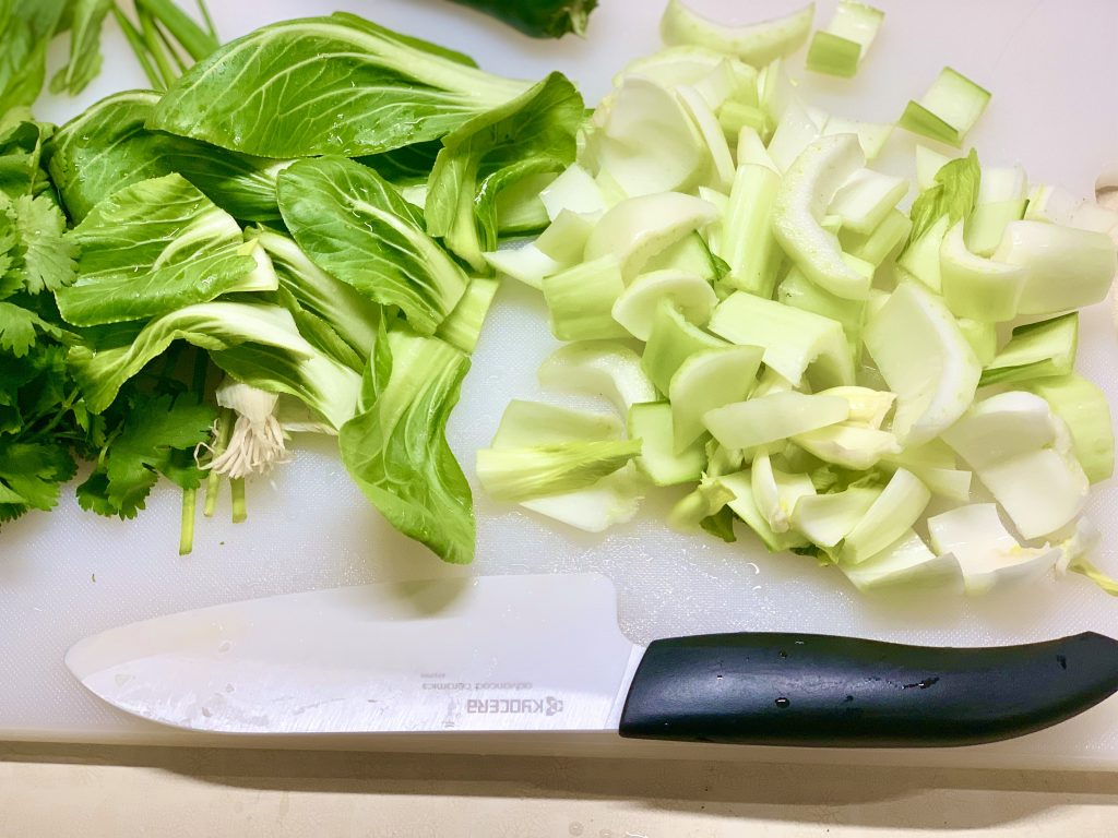 Chopped Bok Choy with leaves set aside to add to soup at the end