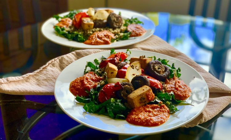 kebabs with romesco on white plates