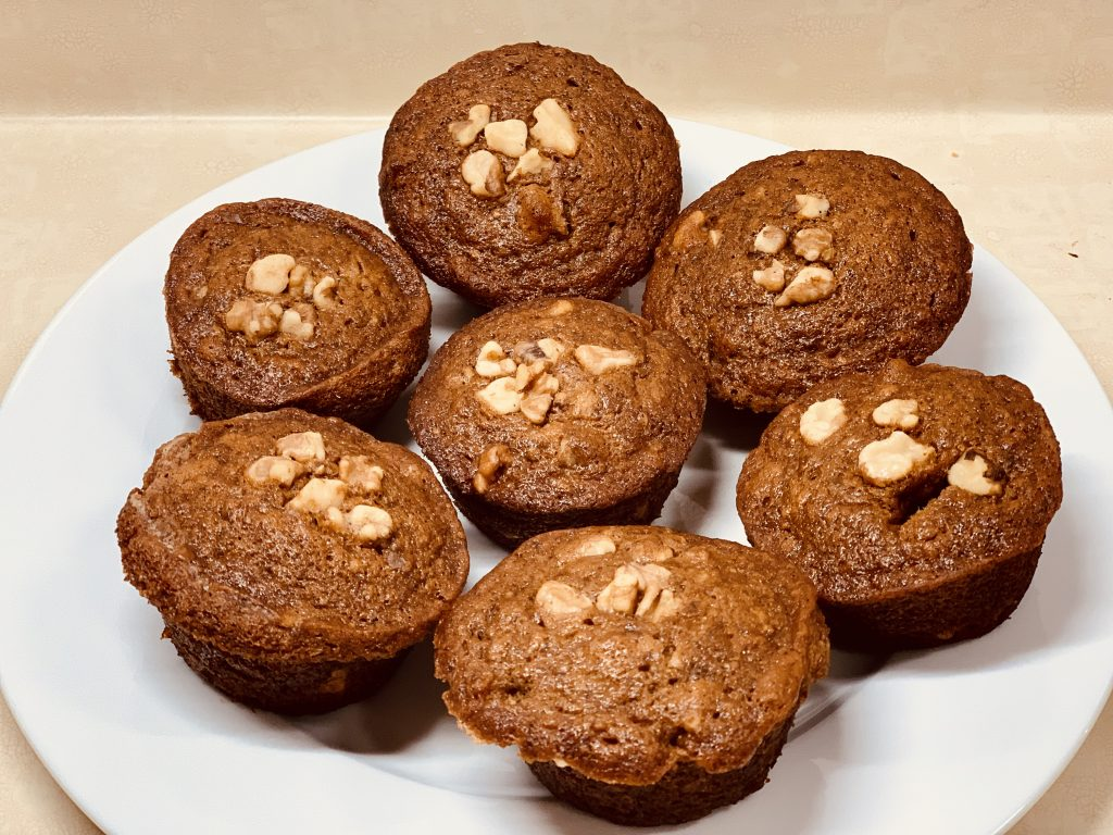 A white plate of Vegan Banana Bread Muffins
