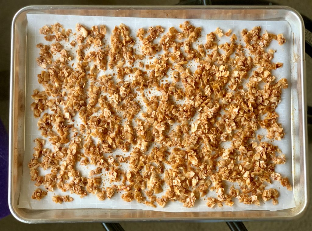 coconut bacon on a baking sheet ready to bake