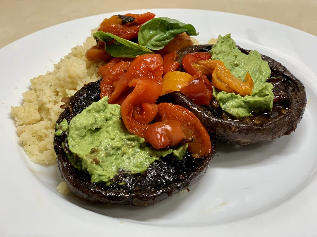 Easy Oven-Roasted Marinated Portobello Mushrooms with Zesty Avocado Pistachio Pesto, Roasted Peppers, and Couscous.