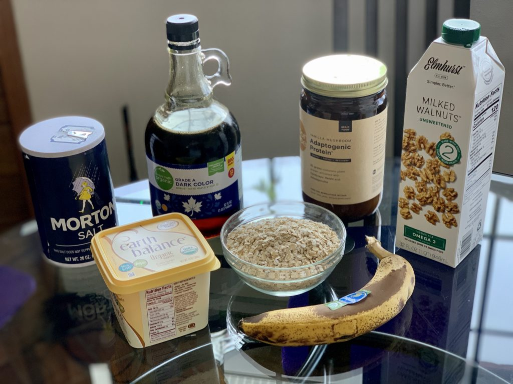 Ingredients for Easy Cakes (Minimalist Gluten-Free Vegan Protein Pancakes): Salt, Earth Balance, Maple Syrup, oats, protein powder, banana walnut milk.