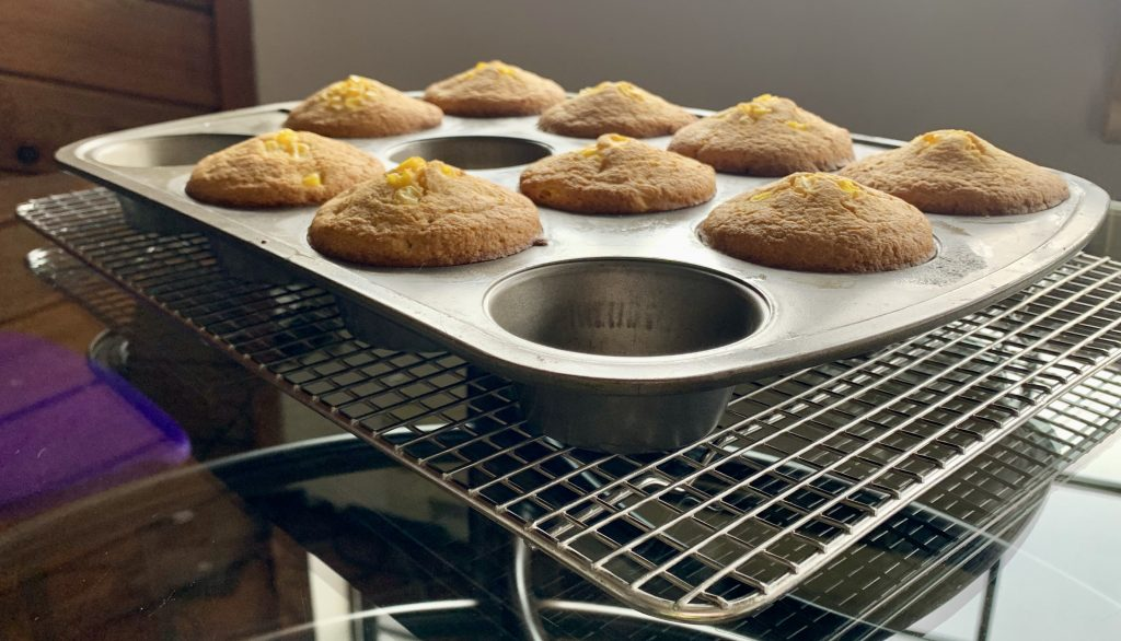 High-Altitude Homemade Oil-Free Vegan Cornbread muffins cooling on a wire rack