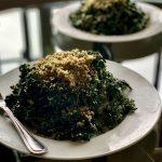 Massaged Kale Ribbon Vegan Caesar Salads on white chilled plates
