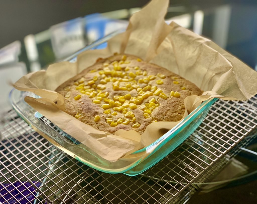 Adding 1/4 cup frozen corn kernels 10 on top minutes into baking