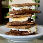 Homemade Cinnamon-Sugar Vegan Graham Crackers in Easy Oven S'mores stacked on a small white plate