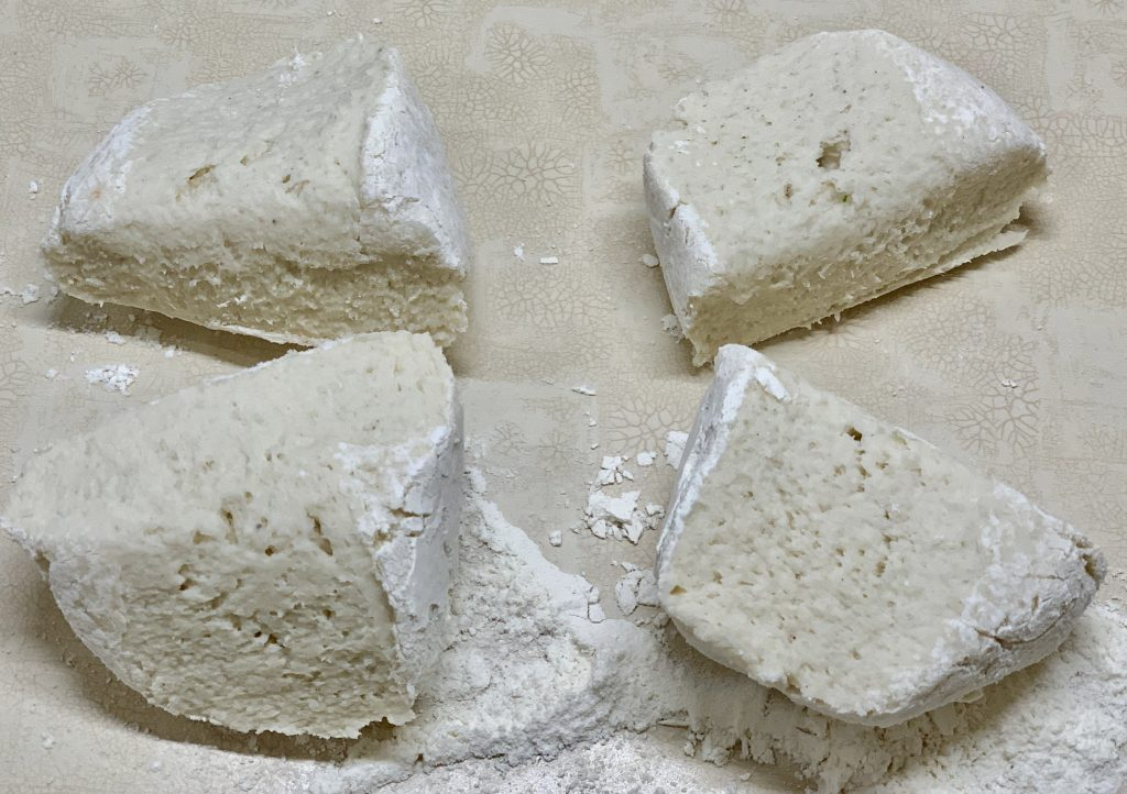 Gnocchi dough cut into four sections