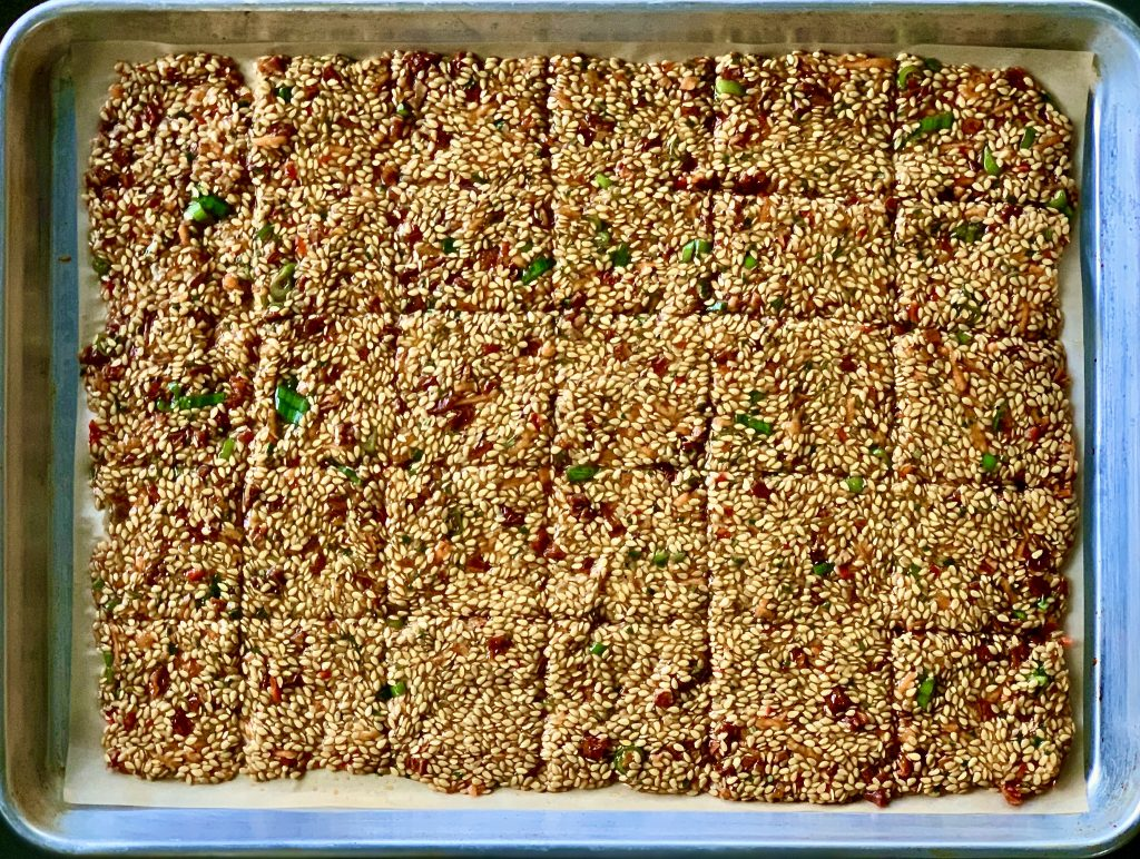 Scored Rosemary Oven-Baked Sun-Dried Tomato Whole Flaxseed Crackers ready for the oven