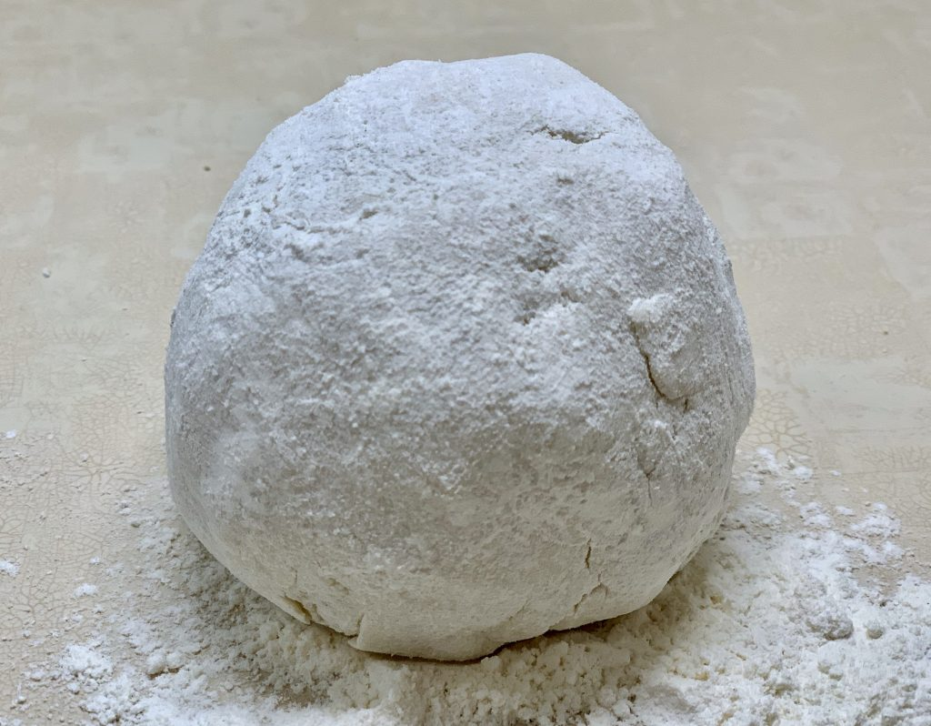 Floured ball of cauliflower gnocchi dough