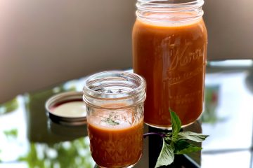 Silky Spanish Farmhouse Gazpacho in a big jar and a small jar with Thai Basil