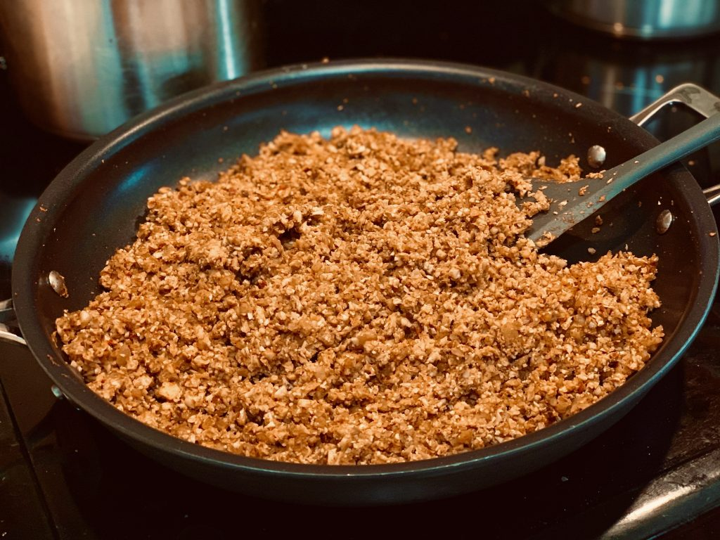 Easy Vegan Cauliflower Walnut Taco Meat browned in a pan on the stove