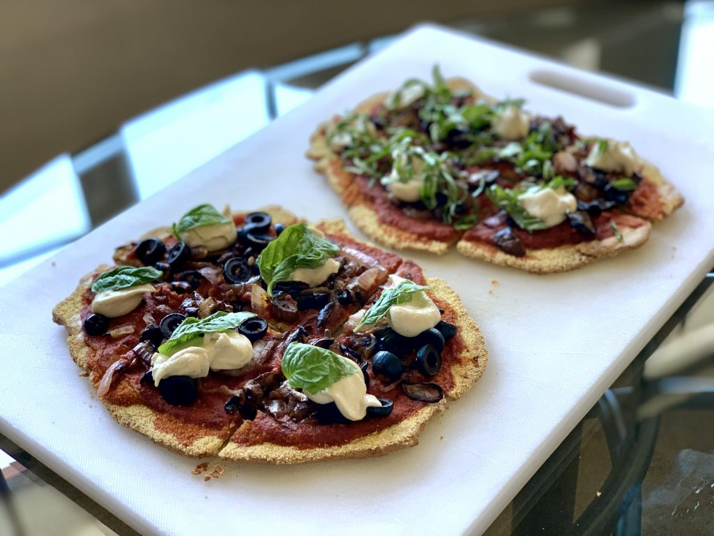 personal pizzas with quinoa flatbread Topped with basil