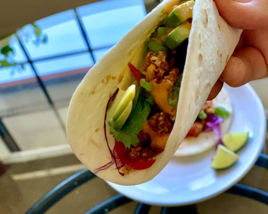 Eating tacos with Easy Vegan Cauliflower Walnut Taco Meat