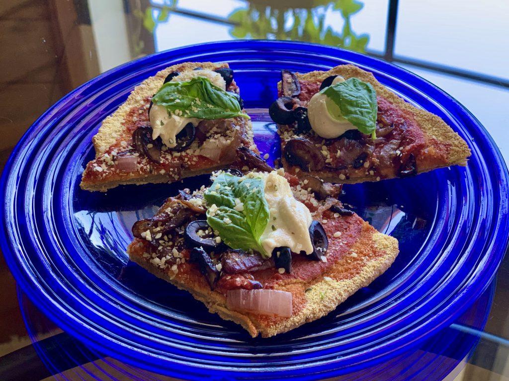 Slices of personal pizzas with quinoa flatbrea
