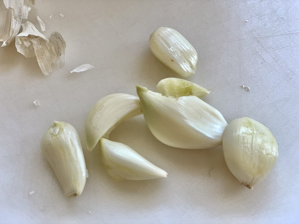 Six fat, crushed and peeled garlic cloves