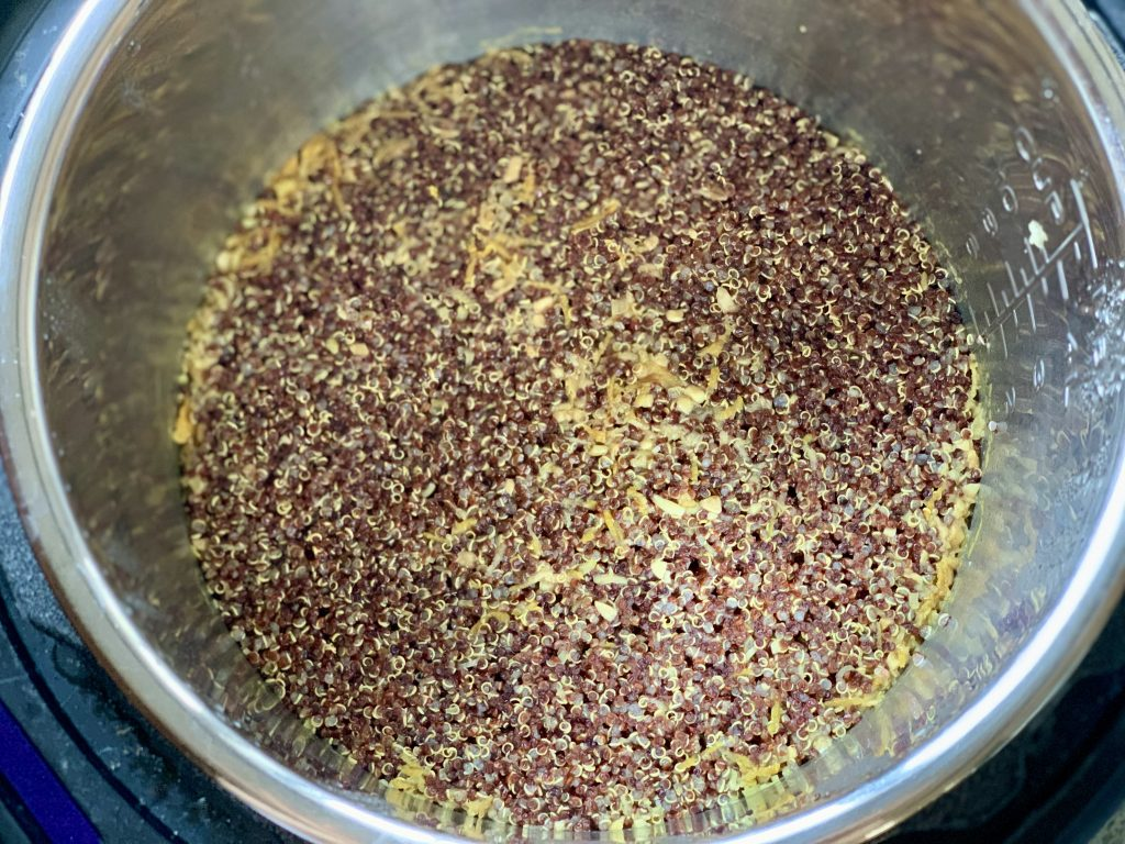 The cooked grains after removing the lid, before stirring