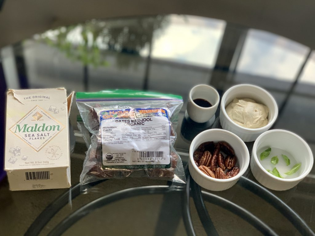 Ingredients for Easy Vegan Cream Cheese Stuffed Dates: Flaked sea salt (optional), Dates, Maple Pecans (optional) Date Syrup (optional) Vegan cream cheese, and basil (optional)