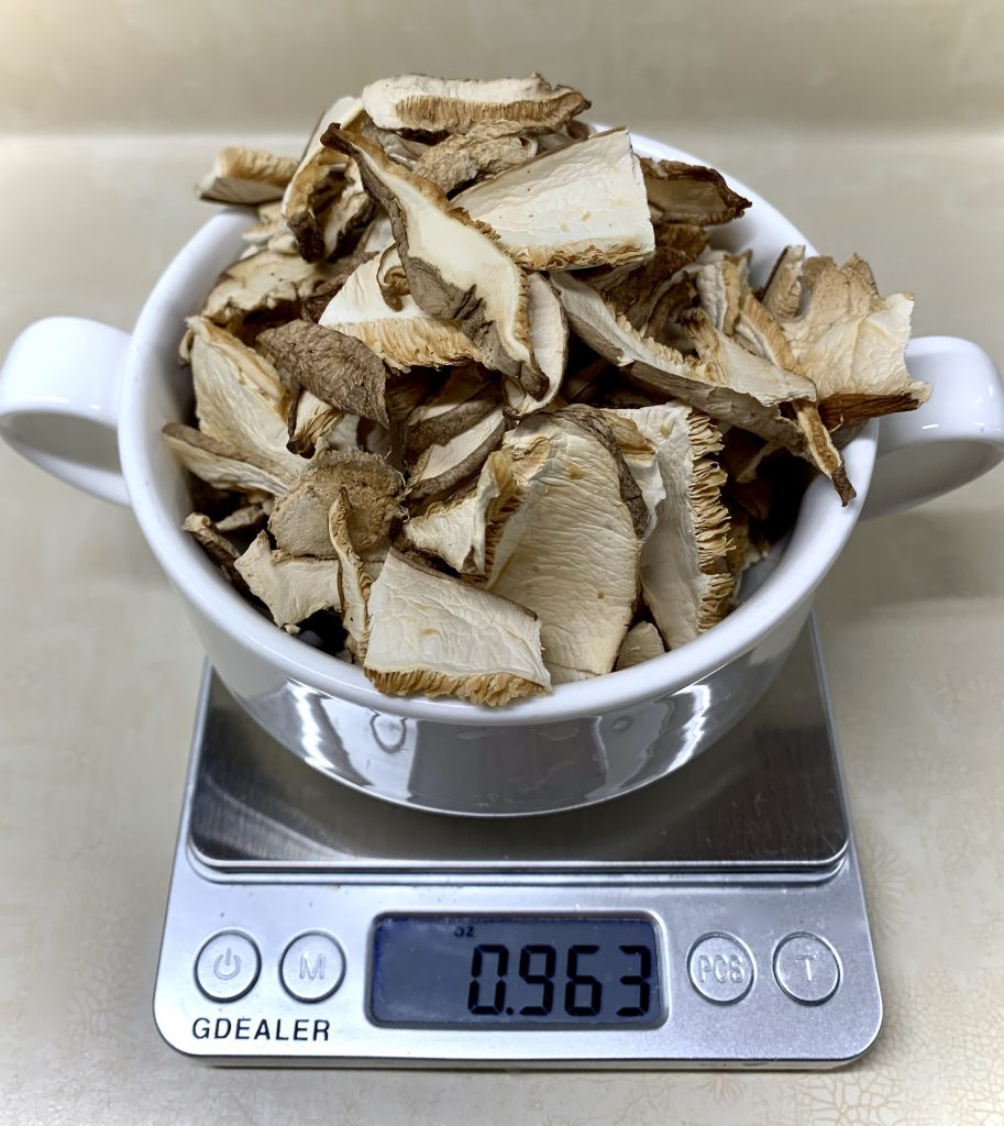 weighing dried shiitake mashrooms for Miso Rice Cake Soup