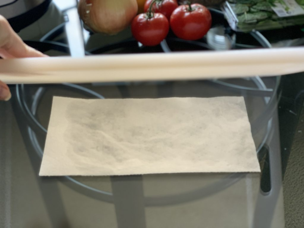 Placing a damp paper towel under the cutting board to keep it in place