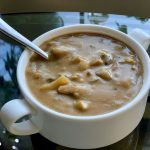 Amazing vegan mushroom gravy in a white cup