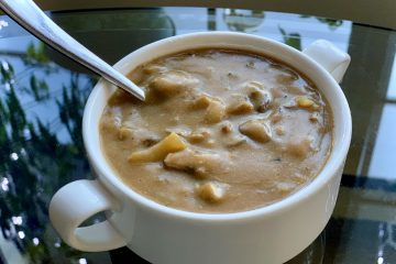Amazing vegan mushroom gravy in a white cup