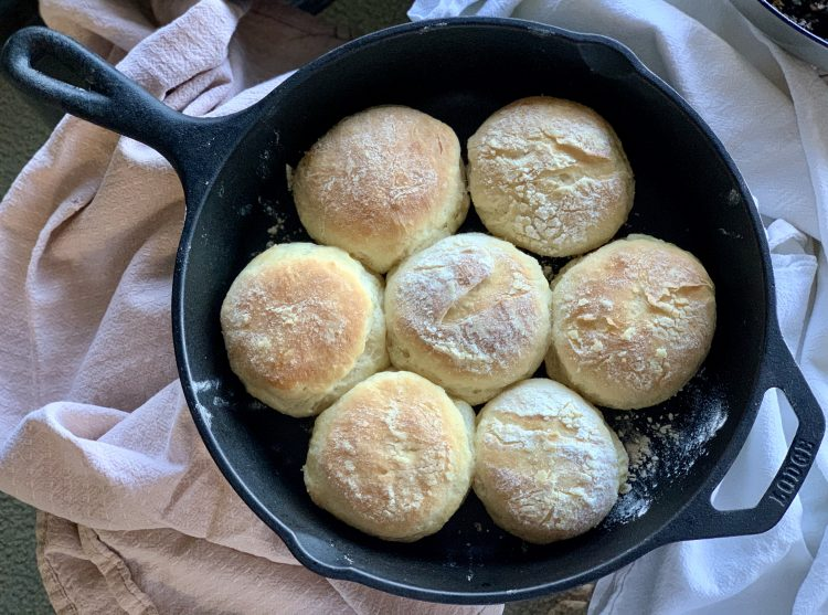 Vegan Sourdough Starter Biscuits in a cast iron skillet over a blush linen
