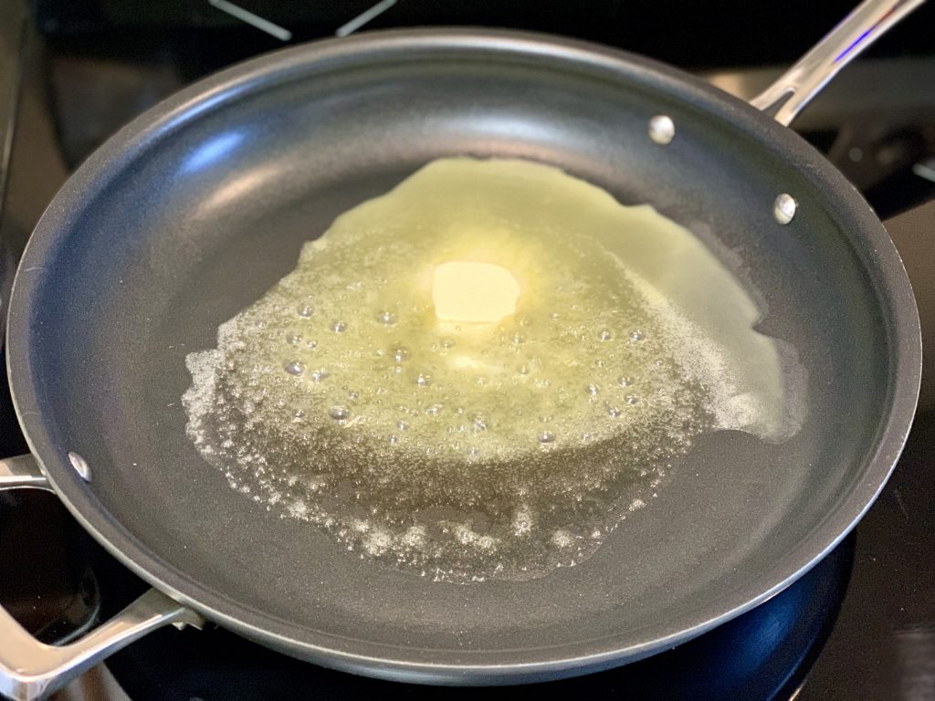 Melting Earth Balance in a large skillet to make Amazing Creamy Vegan Biscuit Gravy