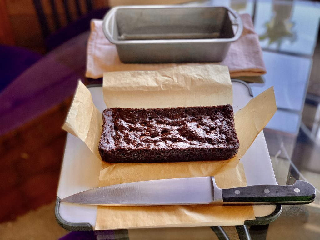 Small-Batch High-Altitude Vegan Brownies cooling for 15 - 30 more minutes out of the pan before cutting