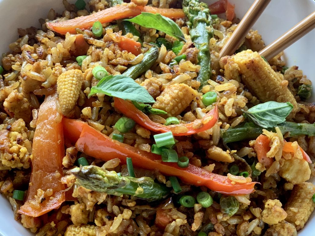 Veggie Tofu Fried Rice topped with sliced scallions and Thai basil