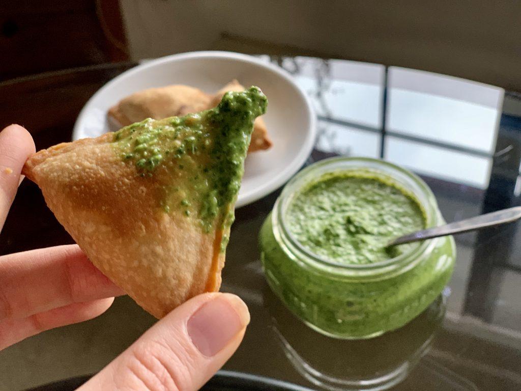 Petite Vegan Potato & Pea Samosas from Whole Foods dipped in Mint Cilantro Chutney (Hari Chutney)