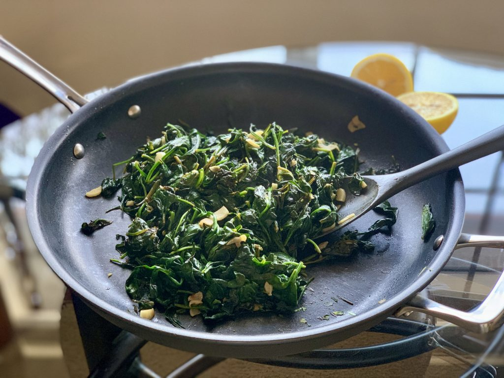 Lemon Garlic Sautéed Spinach in a sauté pan
