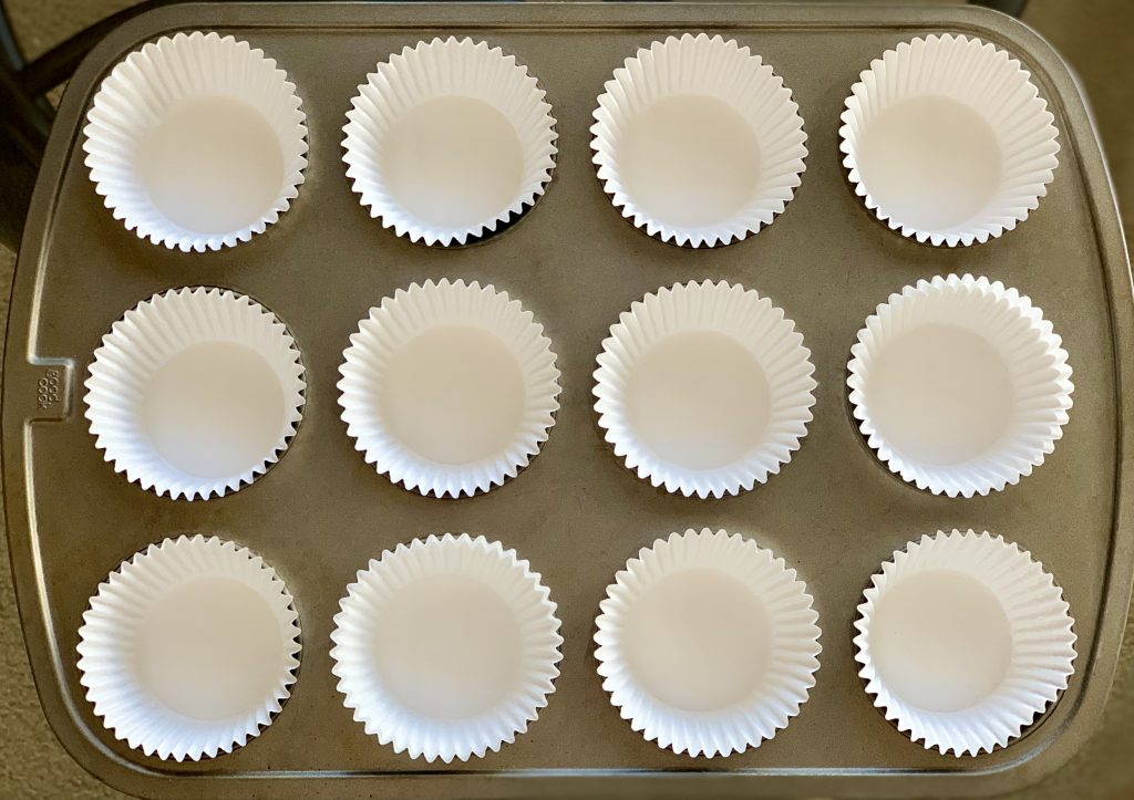 Muffin tin lined with baking cups for High-Altitude Vegan Blueberry Muffins