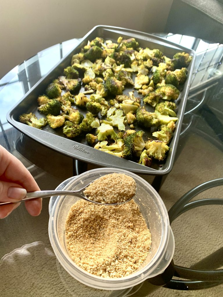 Adding Vegan Garlic Parm to Roasted Broccoli