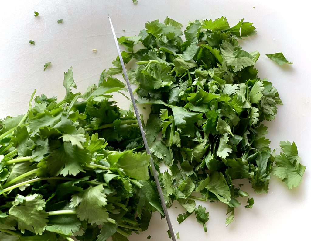 Chopping cilantro for Vegan Marinated Meal-Prep Kebobs (oven or grill)