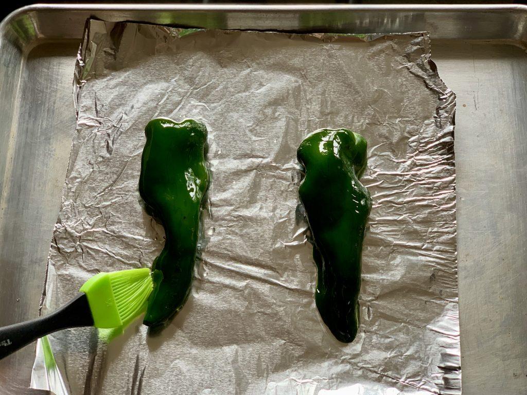 Brushing oil onto Poblano pepper Chipotle-Style Corn Salsa
