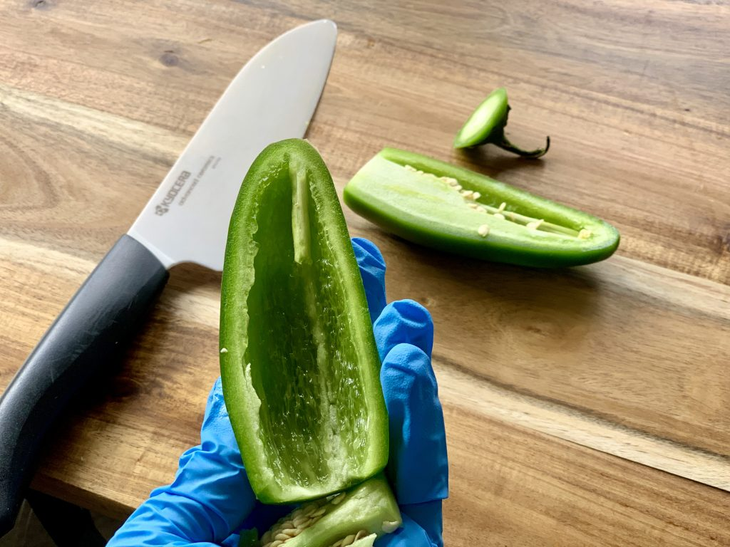 Wearing food gloves when prepping jalapeño for Chipotle-Style Corn Salsa