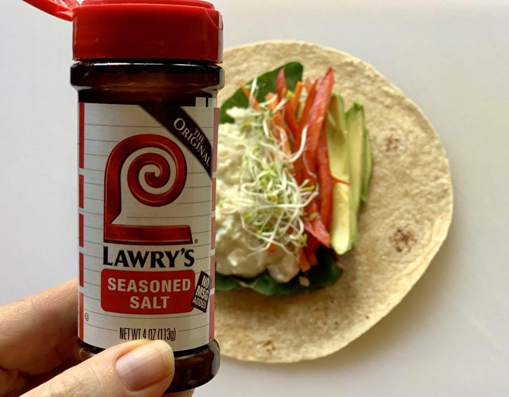 Adding Lawry's Seasoned Salt to Grilled Avocado & Vegan Crab-less Salad Wrap