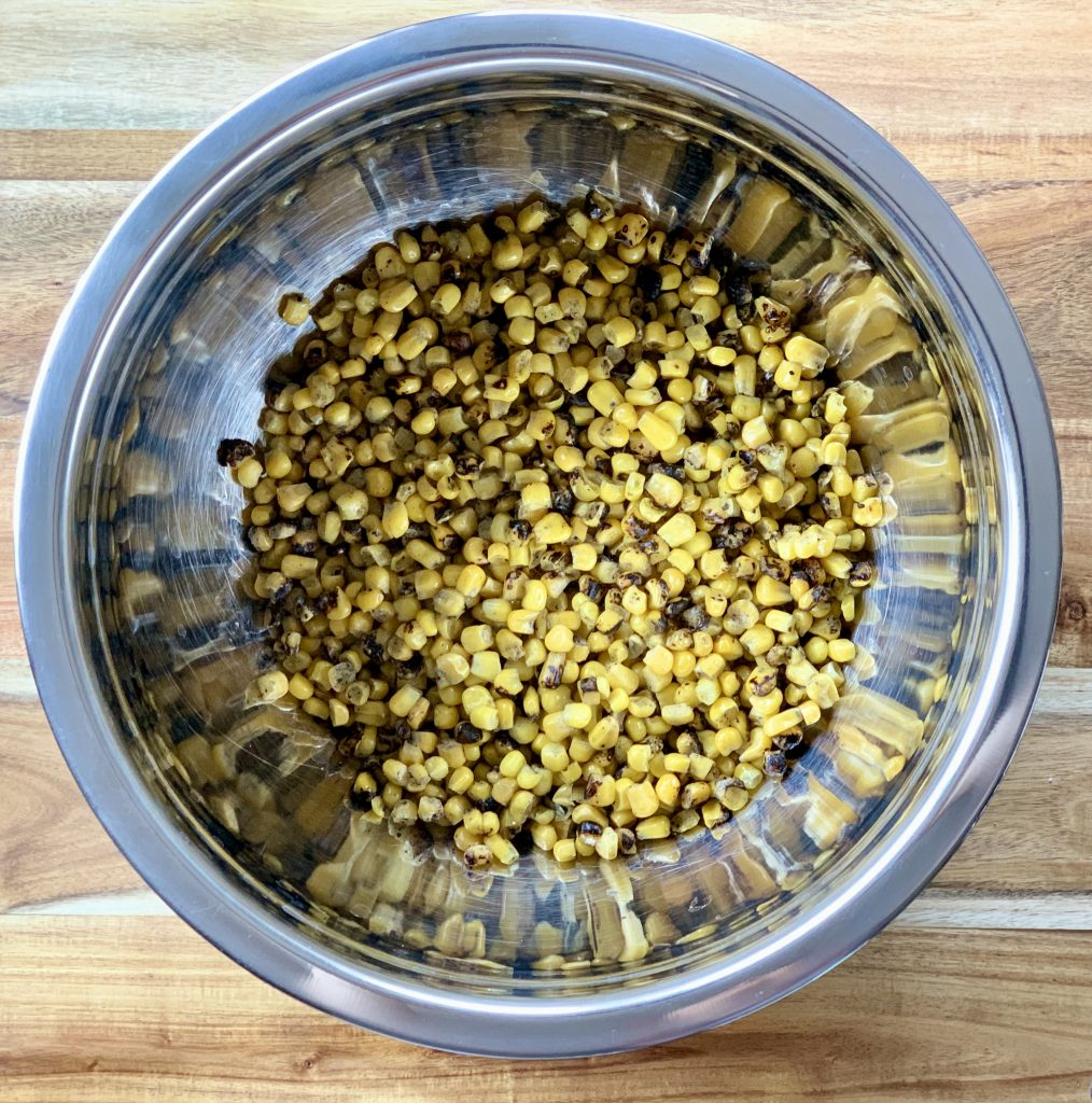 Fire-roasted Frozen Corn in a big bowl for Chipotle-Style Corn Salsa