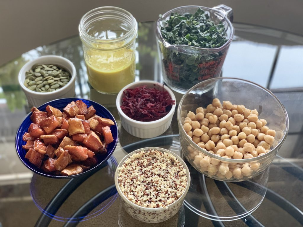 Prepped bowl ingredients for Glazed Yam & Kale Bowls with Orange-Ginger Tahini Sauce