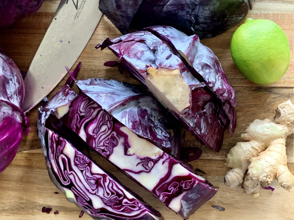 cutting cabbage for Purple-Ginger Antioxidant Juice