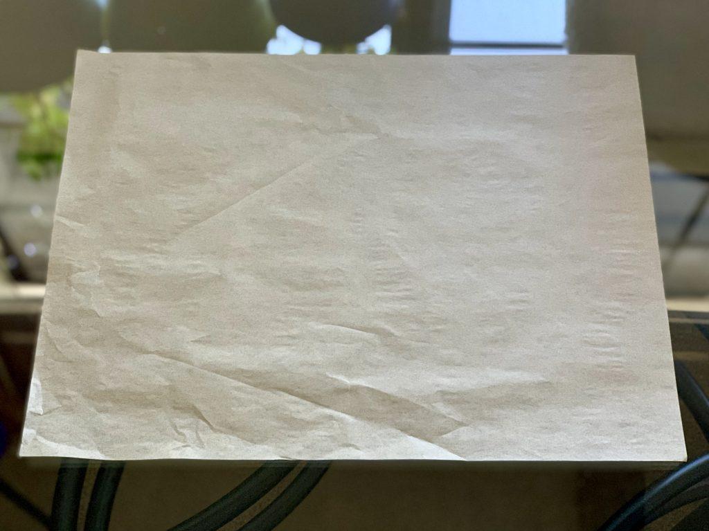 Pre-cut, unbleached parchment paper waiting for Maple Pecans