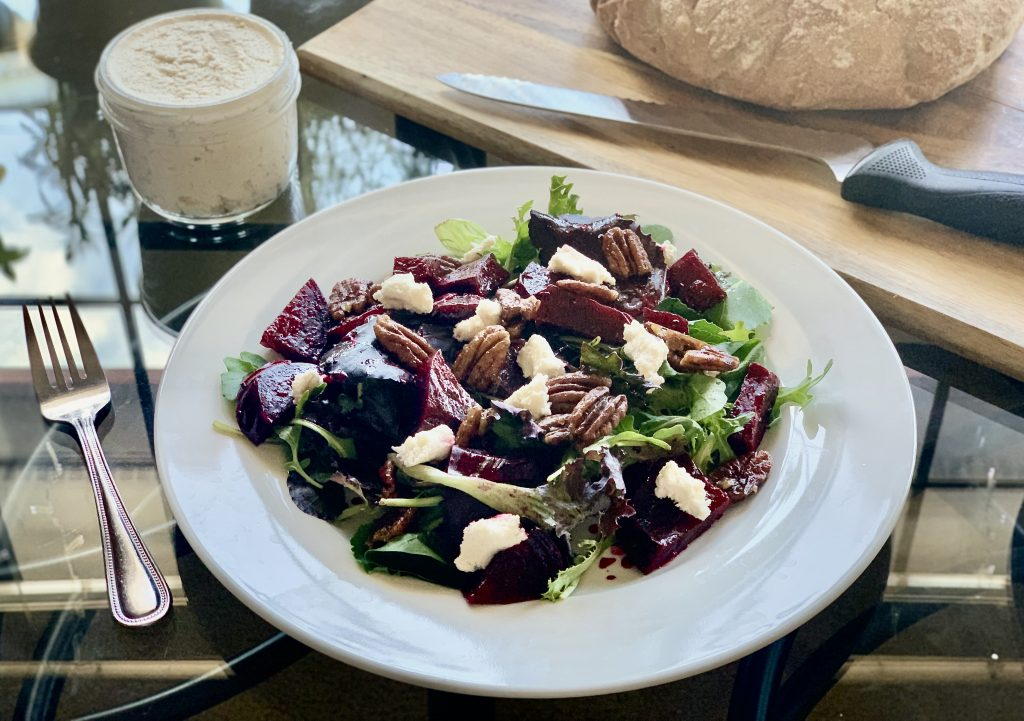 Rosemary Citrus Beet Salad with Maple Pecans topped withLux Vegan Macadamia Ricotta